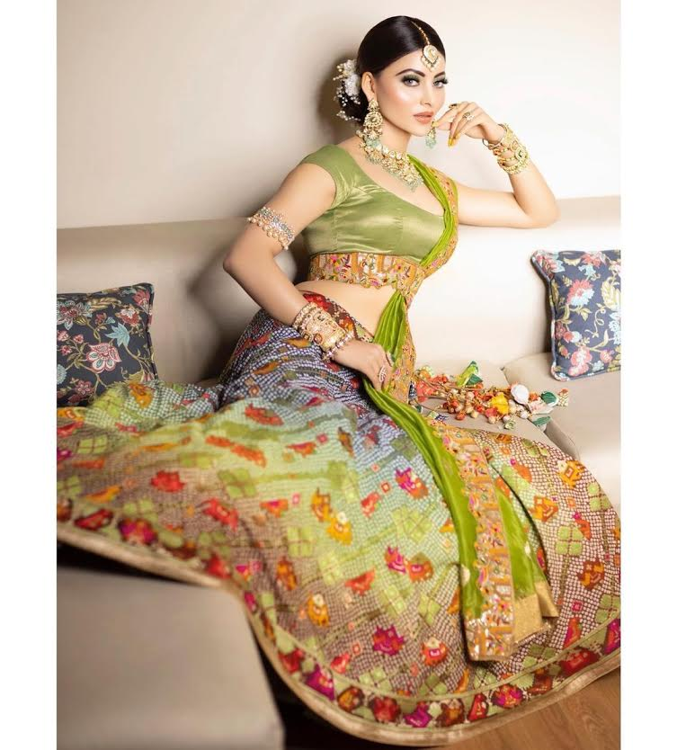 Urvashi Rautela giving traditional vibes in bandhani lehenga and statement jewellery for a recent wedding!
